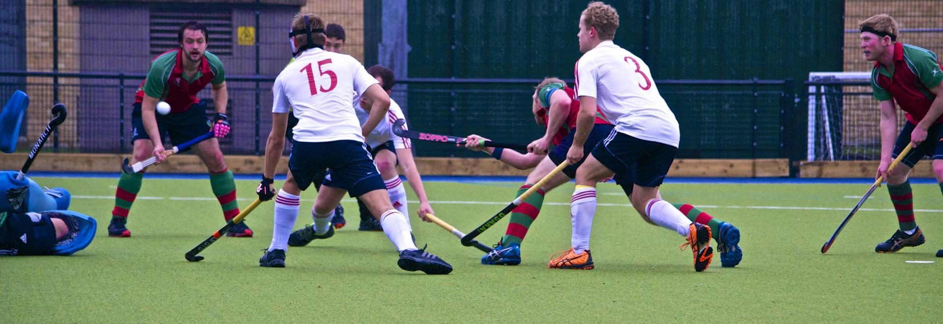 Men playing hockey